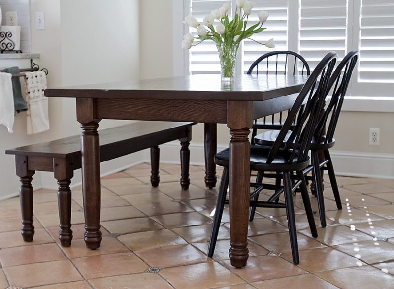 dark stained and finished farmhouse table and chairs with bench