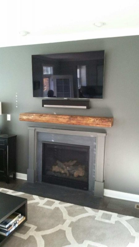 reclaimed wood mantle above fireplace